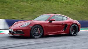 porsche dark red new porsche 718 gts range out accelerates a 911 carrera motoring