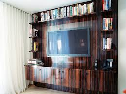 family room with wall units for media entertainment and mounted