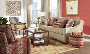 transitional sofa with oversized nailheads and toss pillows by