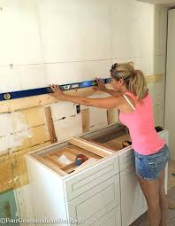 installing cabinets in kitchen how to install upper kitchen cabinets truequedigital info