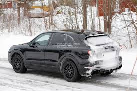 2018 porsche cayenne spied shows active rear spoiler autoevolution