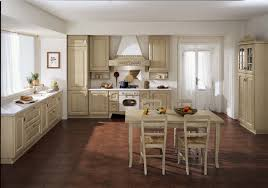 custom kitchen antique white of cabinetry with dining table and
