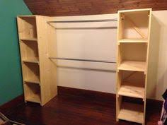 take a couple of book shelves and add some rods in between the