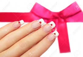beautiful french manicure with pink and red hearts on the nails