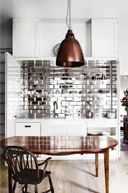 splashback ideas for kitchens mirrored kitchen splashback copper pendant light mar13 kitchen