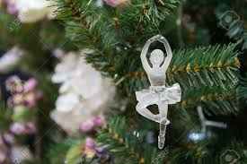 glass ballet dancer on a tree stock photo picture and