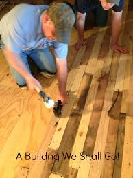 How To Lay Wood Laminate Flooring A Building We Shall Go The Art Of Pallet Wood Flooring