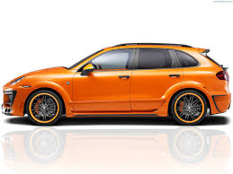 porsche lumma 2012 lumma design porsche cayenne orange metallic studio side