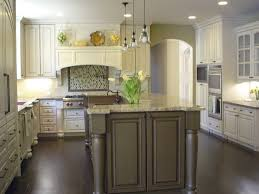 40 inviting contemporary custom kitchen designs layouts white cabinetry over light green walls brighten this kitchen featuring a large dark island with