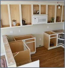 building kitchen cabinets how to build your own kitchen cabinets blogher painting inside