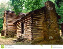 old log pioneer home with a rock fireplace stock photo image