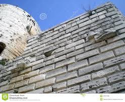 Krak Des Chevaliers by Castle Krak Des Chevaliers Kalaat Al Hosn In Syria Stock Photo