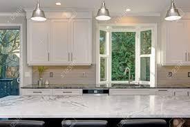 white kitchen cabinets with taupe backsplash luxury home interior boasts amazing white kitchen with custom