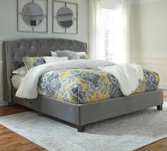 signature design by ashley kasidon queen upholstered bed in gray