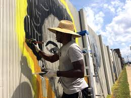the freedom wall buffalo rising ak public art mural projects are generously underwritten by the new era cap foundation additional support for this mural has been provided by hyatt s