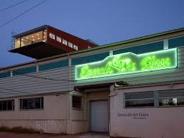 unconventional emerald floating glass house in pittsburgh night