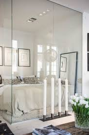 frosted glass partition wall charcoal and white bedding bedroom