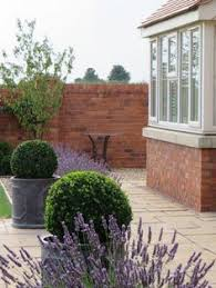 English Box Topiary - lead planter classical lead planters with circle garden