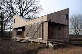 an energy efficient home with a folded roof asgk design small