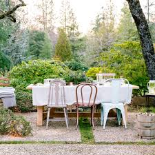how to set the mood for a chic garden party mismatched chairs
