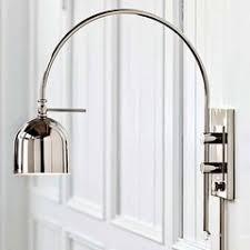lighting above a wall mounted bathroom medicine cabinet