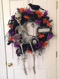 halloween decoration skeleton wreath by a ribbon runs through