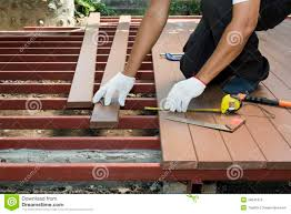 worker installing wood floor for patio stock photo image 34841010