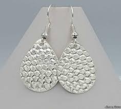silver teardrop earrings pebble texture silver earrings teardrop jewels by rachna