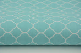 100 small moroccan trellis on a turquoise background