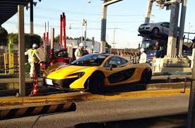 laferrari crash mclaren p1 mounts curb in tollbooth crash in japan