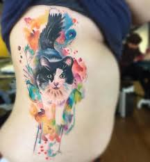 collection of 25 watercolor cat tattoos on thigh