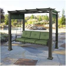 this pergola swing is perfect for lounging outside with your