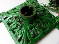 vintage christmas tree stand cast iron w praying christmas