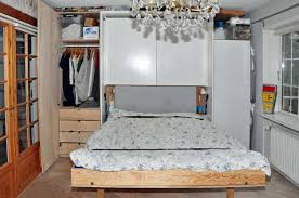 closet behind bed tall murphy bed with extra storage homemade godownsize com