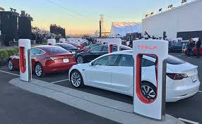 charged evs tesla model 3 will this machine kill the oil age