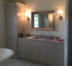 pull out baskets for bathroom cabinets painted inset vanity with linen closet and laundry basket pull out