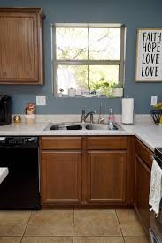 painting kitchen cabinets from white to brown how to paint kitchen cabinets white tutorial rise and
