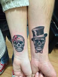 30 couple tattoo ideas female skeleton couple and red ribbon