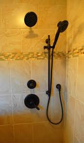 delta lahara shower trim in oil rubbed bronze with hand held unit