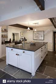 a white country style kitchen in a farmhouse in the uk stock photo