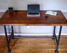 Steel Pipe Desk by The Armory Desk Is Made From Reclaimed Pine And Industrial Black