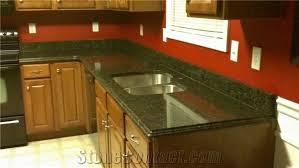 uba tuba green granite kitchen countertop on cherry cabinets