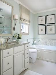 light green bathroom paint striped valances and white built in tub and light green wall color