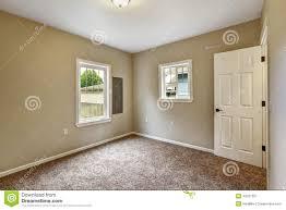 beige empty room with brown carpet floor stock photo image 44231527