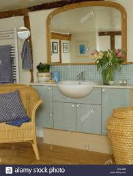 Bathroom Wicker Furniture Large Wood Framed Mirror Above Basin In Pale Blue Fitted Vanity