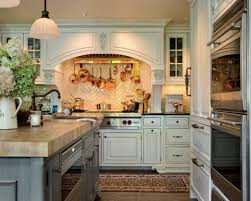 english country kitchen with white cabinets and wall mounted pot