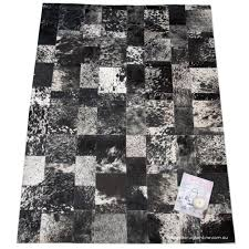 Cowhide Home Decor by Flooring Elegant Rectangle Cowhide Patchwork Rug In Mixed Black