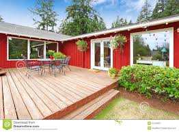 House Patio Bright Red House With Walkout Deck And Patio Area Stock Photo