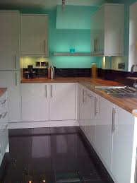 Shiny White Kitchen Cabinets Kitchens With High Gloss Floor Tiles High Gloss White Kitchen
