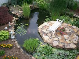 Pond Ideas For Small Gardens by Round Shape Backyard Garden Pond Ideas With Stone Island Complete